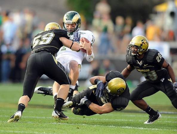 CSU QB Grant Stucker is laid out by B.J.Beatty of CU.<br /> Cliff Grassmick / September 6, 2009