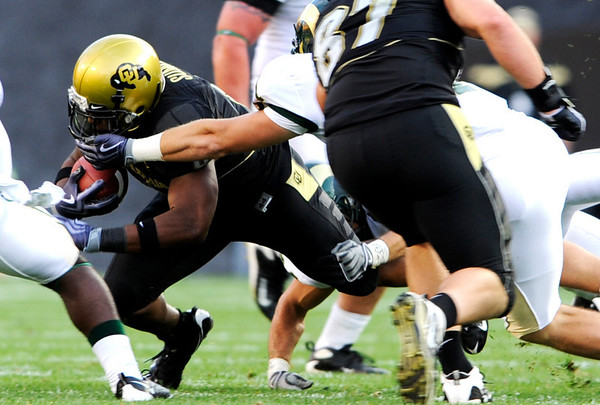 CU's Demetrius Sumler (8) has his face mask grabbbed by CSU's Gerard Thomas (5) at the annual Rocky Mountain Showdown in Folsom Field in Boulder, Colorado on Sunday, Sept. 6, 2009.<br /> KASIA BROUSSALIAN / THE CAMERA
