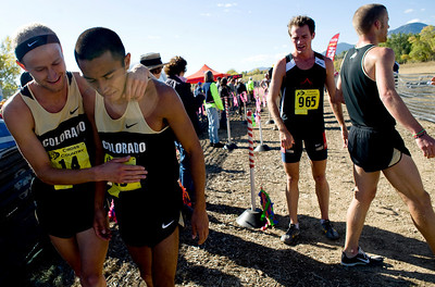 CU senior Kenyon Neuman (left) congratulates junior teammate Richard Medina after finishing at the Rocky Mountain Shootout Cross Country race at the University of Colorado's south campus, Saturday, Oct. 3, 2009.  KASIA BROUSSALIAN / THE CAMERA