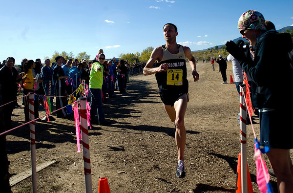 CU senior Kenyon Neuman crosses over the finish line, placing first at the Rocky Mountain Shootout Cross Country race at the University of Colorado's south campus, Saturday, Oct. 3, 2009. <br /> KASIA BROUSSALIAN / THE CAMERA