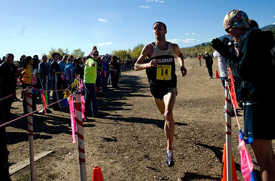 CU senior Kenyon Neuman crosses over the finish line, placing first at the Rocky Mountain Shootout Cross Country race at the University of Colorado's south campus, Saturday, Oct. 3, 2009.  KASIA BROUSSALIAN / THE CAMERA
