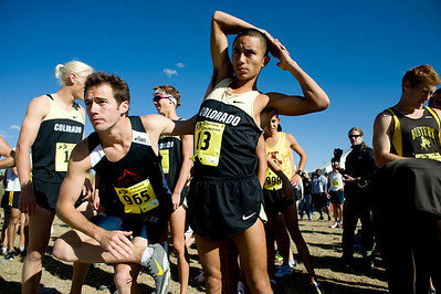 CU junior Richard Medina (right) stretches before the start of the Rocky Mountain Shootout Cross Country race at the University of Colorado's south campus, Saturday, Oct. 3, 2009.  KASIA BROUSSALIAN / THE CAMERA