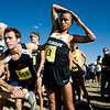 CU junior Richard Medina (right) stretches before the start of the Rocky Mountain Shootout Cross Country race at the University of Colorado's south campus, Saturday, Oct. 3, 2009. <br /> KASIA BROUSSALIAN / THE CAMERA