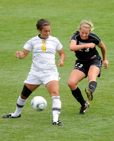 "University of Colorado's Anne Stuller, right,  takes a shot on goal past Colorado College's Sierra Keeler during a soccer game against Colorado College on Friday, Aug. 19, at the University of Denver. CU won the game 5-0. For more photos of the game go to  <a href=""http://www.dailycamera.com"">http://www.dailycamera.com</a><br />  Jeremy Papasso/ Camera"