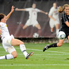 "University of Colorado's Caroline Danneberg, right, passes the ball to a  teammate during a soccer game against Colorado College on Friday, Aug. 19, at the University of Denver. CU won the game 5-0. For more photos of the game go to  <a href=""http://www.dailycamera.com"">http://www.dailycamera.com</a><br />  Jeremy Papasso/ Camera"