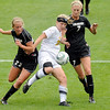 "University of Colorado's Anne Stuller, left, and Shaye Marshall, right, double team Kelsey Wise, of Colorado College, while trying to steal the ball during a soccer game against Colorado College on Friday, Aug. 19, at the University of Denver. CU won the game 5-0. For more photos of the game go to  <a href=""http://www.dailycamera.com"">http://www.dailycamera.com</a><br />  Jeremy Papasso/ Camera"