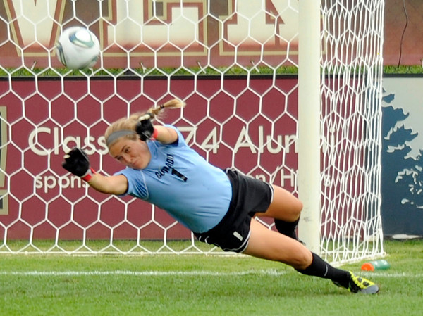 "University of Colorado's Annie Brunner makes a save during a soccer game against Colorado College on Friday, Aug. 19, at the University of Denver. CU won the game 5-0. For more photos of the game go to  <a href=""http://www.dailycamera.com"">http://www.dailycamera.com</a><br />  Jeremy Papasso/ Camera"