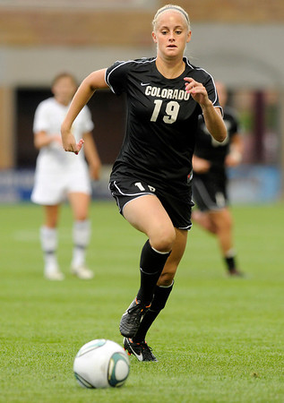 """University of Colorado's Lauren Shaner moves the ball upfield during a soccer game against Colorado College on Friday, Aug. 19, at the University of Denver. CU won the game 5-0. For more photos of the game go to  <a href=""""http://www.dailycamera.com"""">http://www.dailycamera.com</a><br />  Jeremy Papasso/ Camera"""