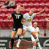 "University of Colorado's Lauren Shaner, left, heads the ball over Beth Wright, of Colorado College, during a soccer game against Colorado College on Friday, Aug. 19, at the University of Denver. CU won the game 5-0. For more photos of the game go to  <a href=""http://www.dailycamera.com"">http://www.dailycamera.com</a><br />  Jeremy Papasso/ Camera"
