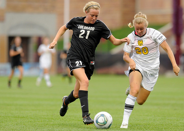 "University of Colorado's Clare Madden dribbles the ball past Sarah Haizlip, of Colorado College, during a soccer game against Colorado College on Friday, Aug. 19, at the University of Denver. CU won the game 5-0. For more photos of the game go to  <a href=""http://www.dailycamera.com"">http://www.dailycamera.com</a><br />  Jeremy Papasso/ Camera"