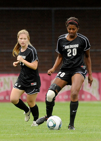 "University of Colorado's Rebecca Boggs passes the ball to a teammate during a soccer game against Colorado College on Friday, Aug. 19, at the University of Denver. CU won the game 5-0. For more photos of the game go to  <a href=""http://www.dailycamera.com"">http://www.dailycamera.com</a><br />  Jeremy Papasso/ Camera"