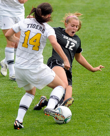 "University of Colorado's Carly Bolyard, right, makes a slide tackle on Colorado College's Kelly Browne during a soccer game against Colorado College on Friday, Aug. 19, at the University of Denver. CU won the game 5-0. For more photos of the game go to  <a href=""http://www.dailycamera.com"">http://www.dailycamera.com</a><br />  Jeremy Papasso/ Camera"