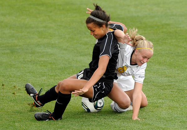"University of Colorado's Bianca Jones, left, collides with Kaeli Vandersluis, of Colorado College, while going for the ball during a soccer game against Colorado College on Friday, Aug. 19, at the University of Denver. CU won the game 5-0. For more photos of the game go to  <a href=""http://www.dailycamera.com"">http://www.dailycamera.com</a><br />  Jeremy Papasso/ Camera"