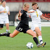 "University of Colorado's Anne Stuller, left, kicks a goal past Colorado College's Jessie Ayers during a soccer game against Colorado College on Friday, Aug. 19, at the University of Denver. CU won the game 5-0. For more photos of the game go to  <a href=""http://www.dailycamera.com"">http://www.dailycamera.com</a><br />  Jeremy Papasso/ Camera"