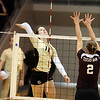 CUVOLLEY<br /> CU's Rosie Steinhaus jumps to drive the ball against Kelsey Black of Texas A&M.<br /> <br /> Photo by Marty Caivano/Camera/Sept. 28, 2010