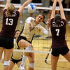 CUVOLLEY<br /> CU's Anicia Santos drives the ball past Chelsea Ringel, left, and Stephanie Minnerly of Texas A&M.<br /> Photo by Marty Caivano/Camera/Sept. 28, 2010