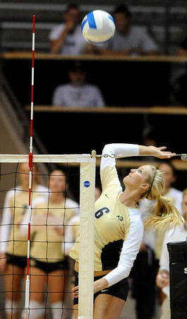 CUVOLLEY<br /> CU's Kerra Schroeder jumps to spike the ball against Texas A&M.<br /> <br /> Photo by Marty Caivano/Camera/Sept. 28, 2010