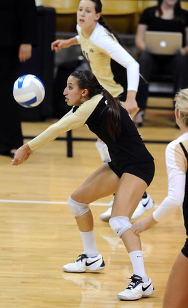 CUVOLLEY<br /> CU's Megan Beckwith puts the ball up against Texas A&M.<br /> Photo by Marty Caivano/Camera/Sept. 28, 2010
