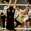 CUVOLLEY<br /> CU's Richi Bigelow spikes the ball past Allie Sawatzky of Texas A&M.<br /> <br /> Photo by Marty Caivano/Camera/Sept. 28, 2010