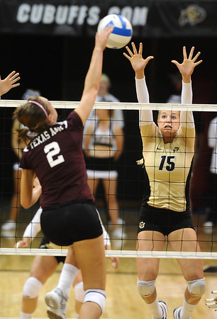 CUVOLLEY<br /> CU's Nikki Lindow jumps to block against Kelsey Black of Texas A&M.<br /> <br /> Photo by Marty Caivano/Camera/Sept. 28, 2010