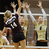CUVOLLEY<br /> CU's Nikki Lindow, left, and Kerra Schroeder block against Lindsey Miller of Texas A&M.<br /> <br /> Photo by Marty Caivano/Camera/Sept. 28, 2010