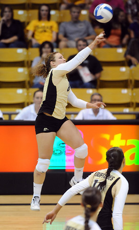 CUVOLLEY<br /> CU's Richi Bigelow fires the ball over the net against Texas A&M.<br /> Photo by Marty Caivano/Camera/Sept. 28, 2010