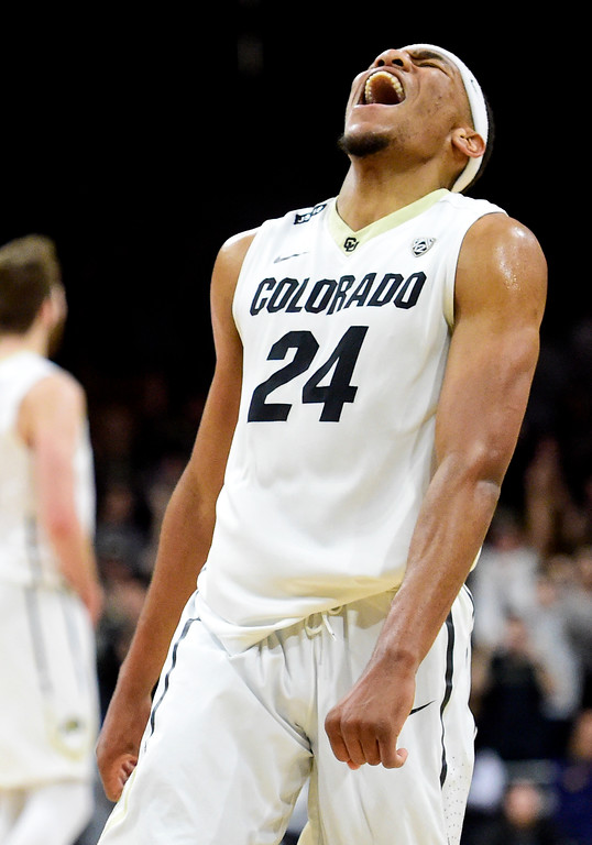 . University of Colorado\'s George King (No. 24) reacts to a three point shot to strengthen the lead over Stanford at the Coors Event Center in Boulder, Colorado on Feb. 11, 2018. (Photo by Matthew Jonas/Staff Photographer)