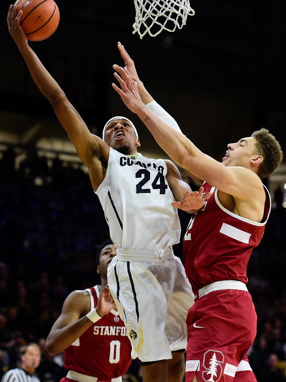 . University of Colorado\'s George King (No. 24) puts up a shot past Stanford\'s Reid Travis (No. 22) at the Coors Event Center in Boulder, Colorado on Feb. 11, 2018. (Photo by Matthew Jonas/Staff Photographer)