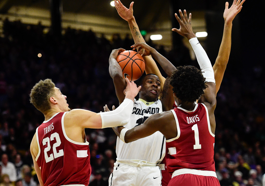 . Stanford\'s Reid Travis (No. 22), Deacon Davis (No. 1) and Trevor Stanback (No. 33) try to block a pass from University of Colorado\'s McKinley Wright (No. 25) at the Coors Event Center in Boulder, Colorado on Feb. 11, 2018. (Photo by Matthew Jonas/Staff Photographer)