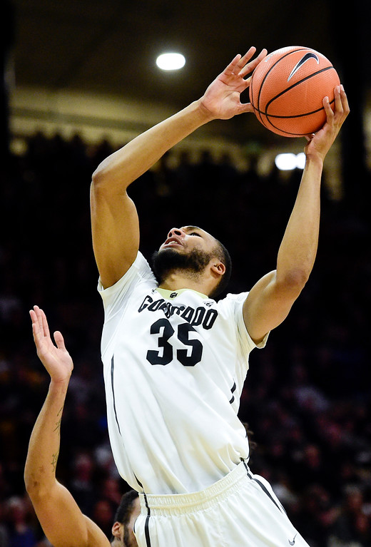. University of Colorado\'s Dallas Walton (No. 35) is fouled while trying to put up a shot over Stanford at the Coors Event Center in Boulder, Colorado on Feb. 11, 2018. (Photo by Matthew Jonas/Staff Photographer)