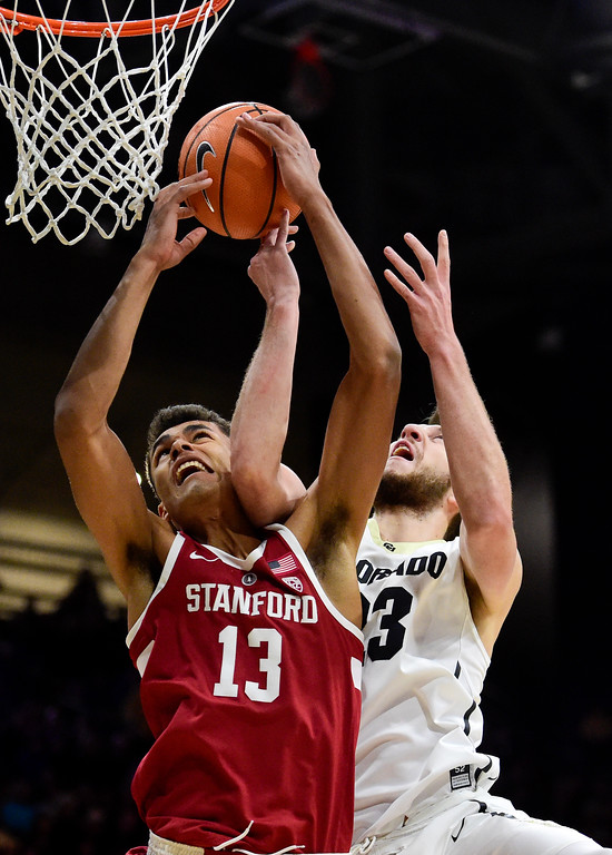 . University of Colorado\'s Lucas Siewert (No. 23) and Stanford\'s Oscar Da Silva (No. 13) battle for a rebound at the Coors Event Center in Boulder, Colorado on Feb. 11, 2018. (Photo by Matthew Jonas/Staff Photographer)