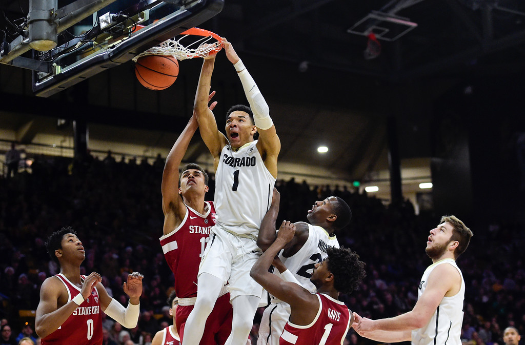 . University of Colorado\'s Tyler Bey (No. 1) dunks on a rebound over Stanford at the Coors Event Center in Boulder, Colorado on Feb. 11, 2018. (Photo by Matthew Jonas/Staff Photographer)