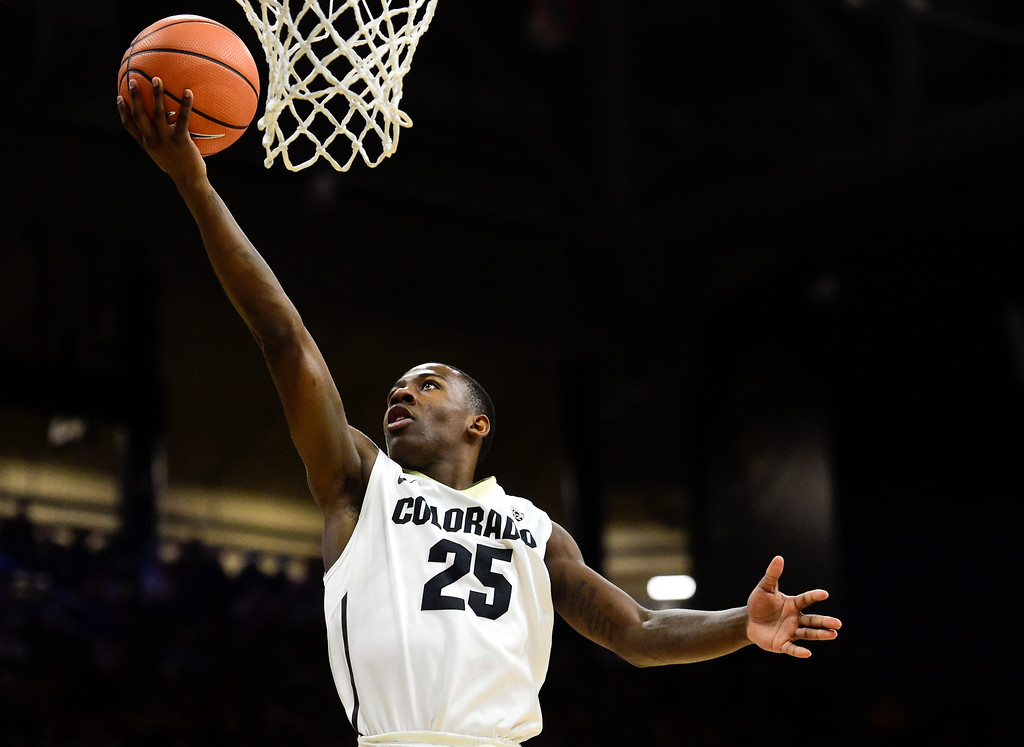 . University of Colorado\'s McKinley Wright (No. 25) puts in a basket against Stanford at the Coors Event Center in Boulder, Colorado on Feb. 11, 2018. (Photo by Matthew Jonas/Staff Photographer)
