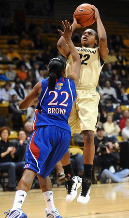 CUKANSAS<br /> CU's Brittany Spears shoots over Marisha Brown of Kansas.<br /> Photo by Marty Caivano/Jan. 12, 2011