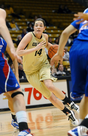 CUKANSAS<br /> CU's Meagan Malcolm-Peck drives to the basket against Kansas.<br /> Photo by Marty Caivano/Jan. 12, 2011