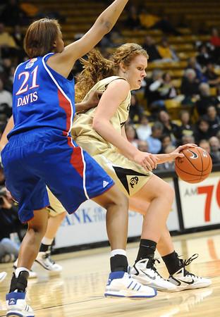 CUKANSAS<br /> CU's Rachel Hargis works against Carolyn Davis of Kansas.<br /> Photo by Marty Caivano/Jan. 12, 2011
