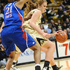 CUKANSAS<br /> CU's Rachel Hargis works against Carolyn Davis of Kansas.<br /> Photo by Marty Caivano/Jan. 12, 2011