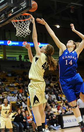 CUKANSAS<br /> CU's Rachel Hargis sinks a shot against Krysten Boogaard of Kansas.<br /> Photo by Marty Caivano/Jan. 12, 2011