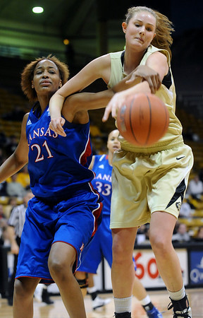 CUKANSAS<br /> CU's Julie Seabrook fights for the ball against Carolyn Davis of Kansas.<br /> Photo by Marty Caivano/Jan. 12, 2011