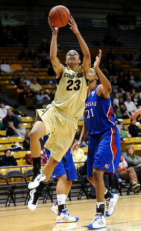 CUKANSAS<br /> CU's Chucky Jeffery gets past Carolyn Davis of Kansas.<br /> Photo by Marty Caivano/Jan. 12, 2011