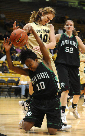 CU<br /> CU's Rachel Hargis fights for a rebound against Charnise Mothershed of North Dakota.<br /> Photo by Marty Caivano/Jan. 4, 2010