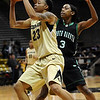 CU<br /> CU's Chucky Jeffery blocks Charnay Mothershed of North Dakota.<br /> Photo by Marty Caivano/Jan. 4, 2010