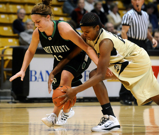 CU<br /> CU's Brittany Spears steals the ball from Nicole Smart of North Dakota.<br /> Photo by Marty Caivano/Jan. 4, 2010