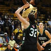CU<br /> CU's Brittany Spears grabs a rebound away from Katie Houdeck of North Dakota.<br /> Photo by Marty Caivano/Jan. 4, 2010