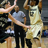 CU<br /> CU's Ashley Wilson looks to pass while being guarded by Megan Lauck of North Dakota.<br /> Photo by Marty Caivano/Jan. 4, 2010