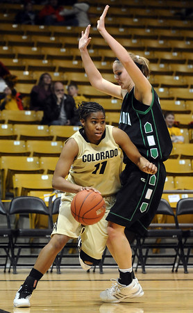CU<br /> CU's Brittany Wilson drives past Megan Lauck of North Dakota.<br /> Photo by Marty Caivano/Jan. 4, 2010