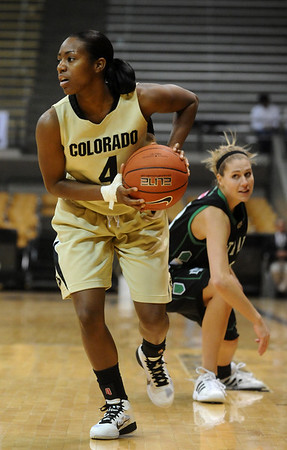 CU<br /> CU's Britney Blythe escapes pressure from Madi Buck of North Dakota.<br /> Photo by Marty Caivano/Jan. 4, 2010
