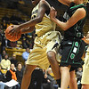 CU<br /> CU's Brittany Spears goes up to shoot against Corey Lof of North Dakota.<br /> Photo by Marty Caivano/Jan. 4, 2010