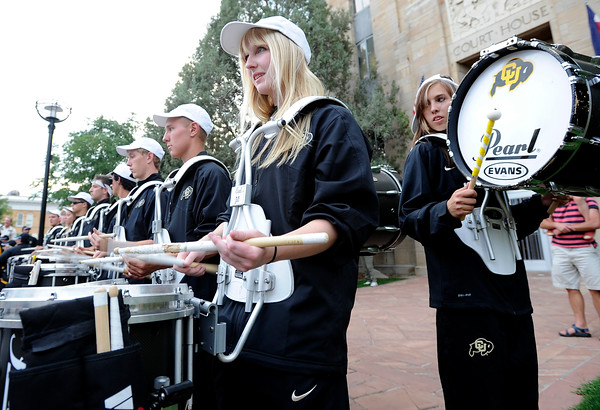 """University of Colorado Drum Line member Anna Coleman, front, plays the snare drum while Lizzie Olsen, right, plays the bass drum on Friday, Aug. 31, during the CU pep rally on Pearl Street in Boulder. For more photos and video of the pep rally go to  <a href=""""http://www.dailycamera.com"""">http://www.dailycamera.com</a><br /> Jeremy Papasso/ Camera"""