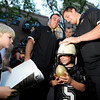"University of Colorado football players Keegan Lamar, right, and Jesse Hiss sign the helmet of Zander Carlyle, 6, while Grayson Strauss, 5, at left, waits to have his poster signed on Friday, Aug. 31, during the CU pep rally on Pearl Street in Boulder. For more photos and video of the pep rally go to  <a href=""http://www.dailycamera.com"">http://www.dailycamera.com</a><br /> Jeremy Papasso/ Camera"